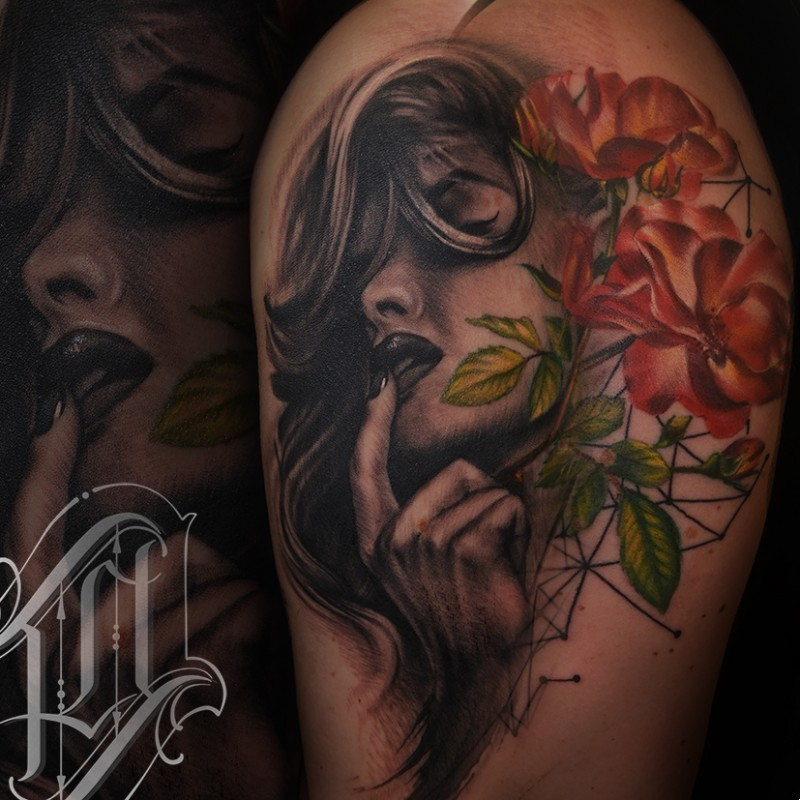 Realistic portrait and flower tattoo
